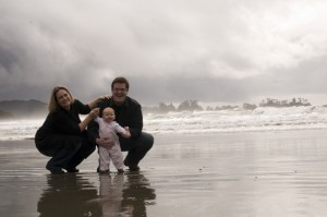 At a Tofino beach with baby and family