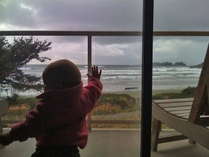standing at tofino hotel for families with a kid-friendly window