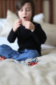 Playmobil vacation on a hotel bed