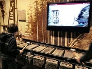 Pounding railroad spikes at MOHAI