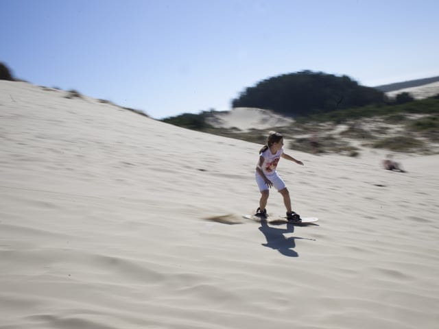 Skateboarding kid at Oregon Dunes in Florence, Oregon